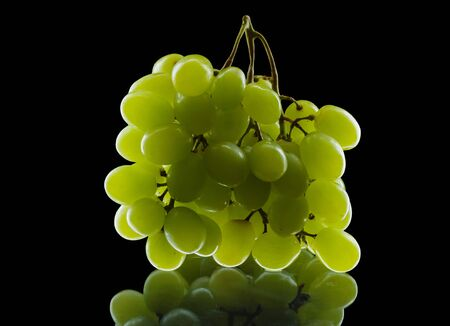 bunch of grapes isolated on black background photo