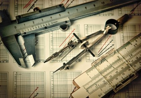 Old engineering tools on a technical drawing photo