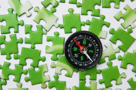 compass on the green puzzle photo