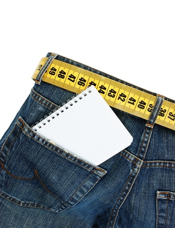 jeans with meter belt slimming and notebook in pocket isolated on the white background photo