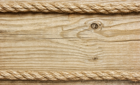 string together: frame made of rope on a wooden background
