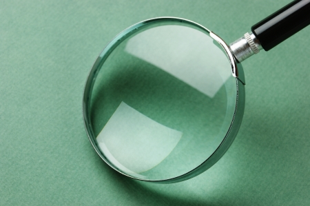 magnified: magnifying glass on green background