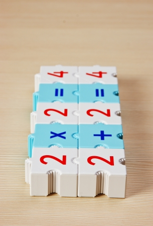 compute: School cubes with math problems on the table