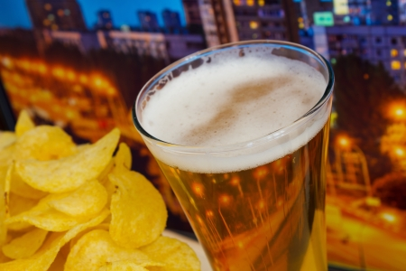 glass of beer and potato chips in a landscape