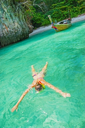 young girl on the beach snorkel Maya Bay on Phi Phi Ley, Thailand photo