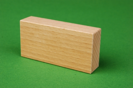 cuboid: wooden geometric shapes on a green background