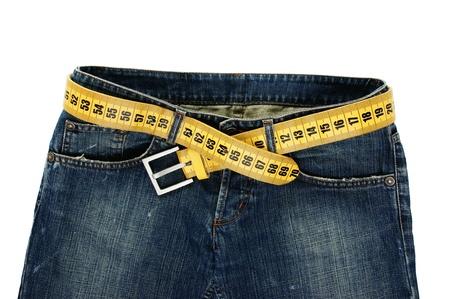 白い背景に分離されたメーター ベルト スリミングとジーンズ 写真素材