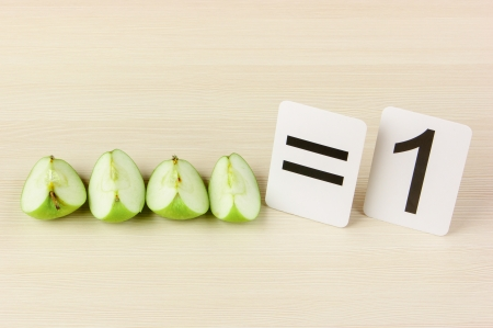 School card and apple with math problems Stock Photo