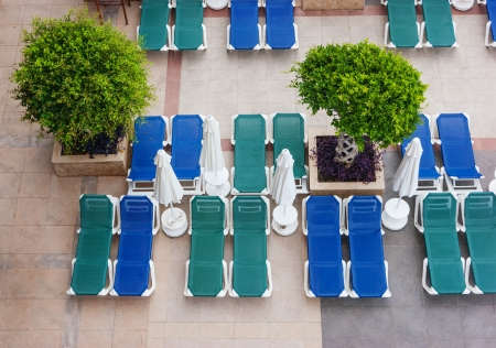 empty sun loungers by the pool photo