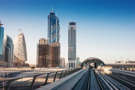 DUBAI, UAE - NOVEMBER 18: A view of the Dubai Marina from the subway car November 18. 2012. Metro is a driverless, fully automated metro rail network.