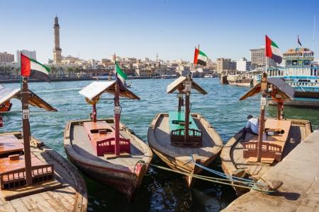 bur dubai: Traditional Abra ferries at the creek in Dubai, United Arab Emirates Editorial