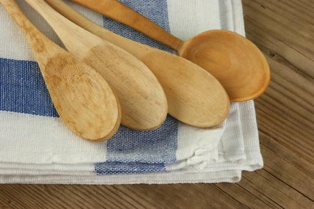 dishcloth: wooden spoon and dishcloth on old wooden table Stock Photo