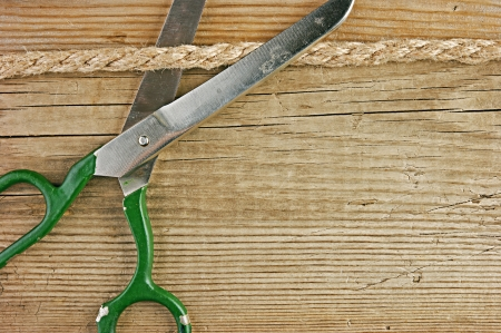 old tailor scissors and rope on the wooden background Stock Photo - 21999046