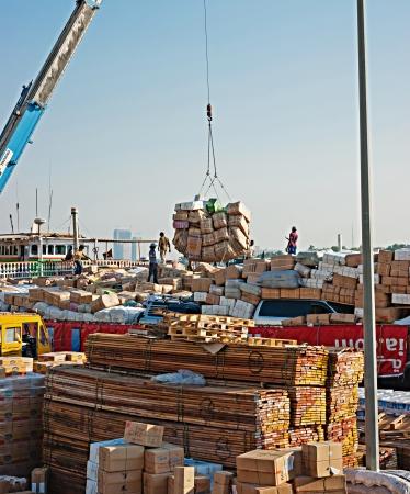 DUBAI, UAE-NOVEMBER 13: Loading a ship in Port Said on November 13, 2012 in Dubai, UAE. The oldest commercial port of Dubai