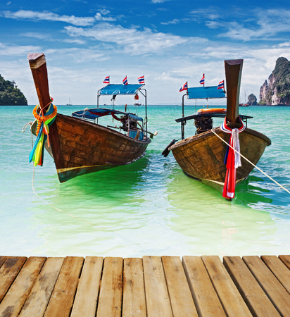 longtail: Traditional longtail boats in the famous Maya bay of Phi-phi Leh island, Thailand