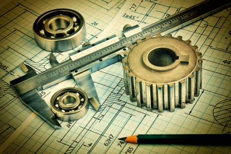 Old technical drawing and pinion with bearings Stock Photo