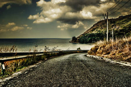 road along the coast in the evening, Phuket, Thailand photo