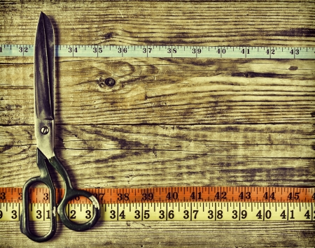 sartorial: sartorial meter and scissors on the old wooden background