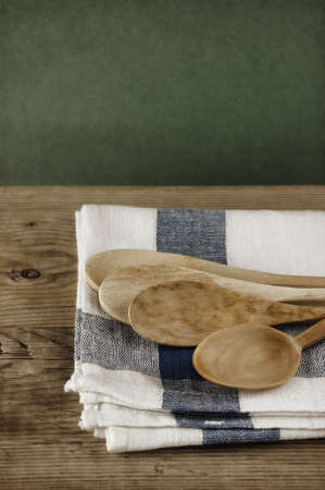 dishcloth: wooden spoon and dishcloth on a wooden table