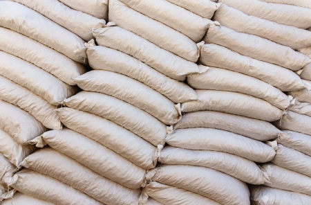 Pile sacks in warehouse photo