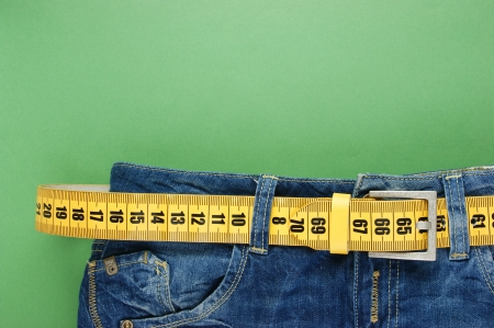 weight loss plan: jeans with meter belt slimming on the green  Stock Photo