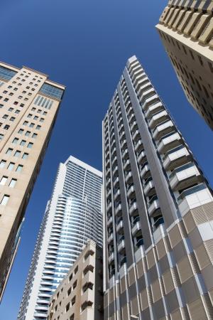 industrialized: SHARJAH, UAE - OCTOBER 28, 2013: Modern buildings in Sharjah. It is the most industrialized emirate in UAE.