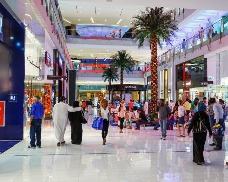 sq: DUBAI, UAE - NOVEMBER 9: Inside modern luxuty mall on November 9, 2013 in Dubai. At over 12 million sq ft, it is the worlds largest shopping mall based on total area.