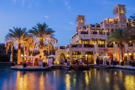 artificial lights: DUBAI, UAE - NOVEMBER 15: Night view of Madinat Jumeirah hotel, on November 15, 2012, Dubai, UAE. Madinat Jumeirah - luxury 5 star hotel with own artificial canals and boats.