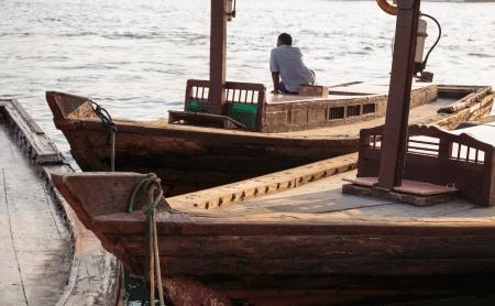bur dubai: Traditional Abra boat at the pier in Dubai Stock Photo