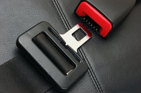 seat belt on a black leather chair Standard-Bild
