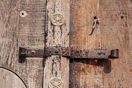 old deadbolt on wooden door photo