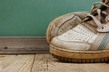 old leather shoes on a wooden floor photo