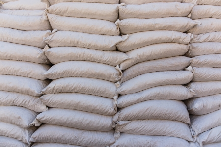 Pile sacks in warehouse Фото со стока