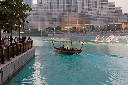 united arab emirate: DUBAI, UAE - OCTOBER 31, 2013: Fountain in the lake near Dubai Mall. Lake - 6600 lights and 25 projectors, it shoots water 150 m into the air. United Arab Emirate Editorial