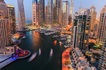 DUBAI, UAE - NOVEMBER 2: Dubai Marina at night from the top, on November 2, 2013, Dubai, UAE. In the city of artificial channel length of 3 kilometers along the Persian Gulf.