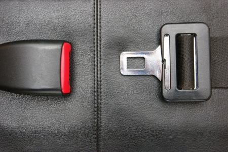 seat belt on a black leather chair Banque d'images