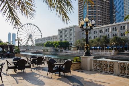 sharjah: SHARJAH, UAE - OCTOBER 28, 2013: Eye of the Emirates - ferris wheel in Al Qasba in Shajah, UAE Editorial