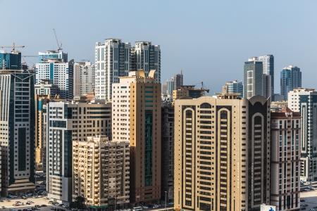 impressive: SHARJAH, UAE - OCTOBER 29, 2013: Sharjah - general view. Sharjah is located along northern coast of Persian Gulf on Arabian Peninsula