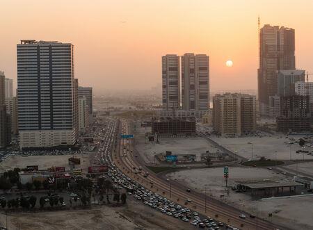 sharjah: SHARJAH, UAE - NOVEMBER 4: Night view of Sharjah, on November 4, 2013. Sharjah is located along northern coast of Persian Gulf on Arabian Peninsula