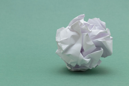 wad: wad of crumpled paper on green background