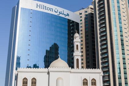 sharjah: SHARJAH, UAE - OCTOBER 28, 2013: Modern buildings in Sharjah. It is the most industrialized emirate in UAE.