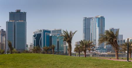 industrialized: SHARJAH, UAE - OCTOBER 29, 2013: Modern buildings in Sharjah. It is the most industrialized emirate in UAE.