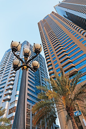industrialized: SHARJAH, UAE - OCTOBER 29,  2013  Modern buildings in Sharjah  It is the most industrialized emirate in UAE