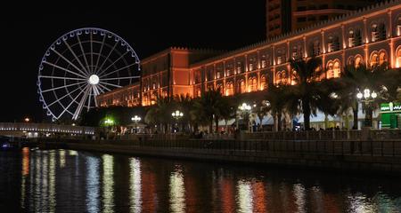 third wheel: SHARJAH, UAE - OCTOBER 29  Ferris wheel in Al Qasba  Sharjah - third largest and most populous city in United Arab Emirates, on October 29, 2013