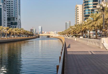 impressive: SHARJAH, UAE - OCTOBER 28,  2013: Modern buildings in Sharjah. It is the most industrialized emirate in UAE.