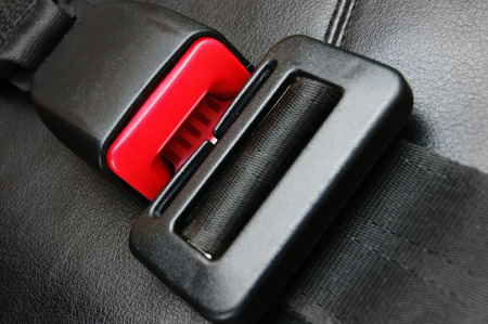 seat belt on a black leather chair photo