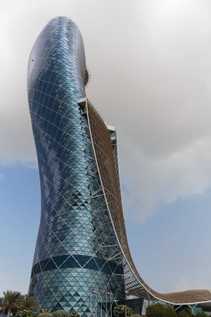 furthest: ABU DHABI, UAE - NOVEMBER 5: The Capital Gate Tower on the November 5, 2013 in Abu Dhabi, This is certified as the Worlds Furthest Leaning Manmade in the world.