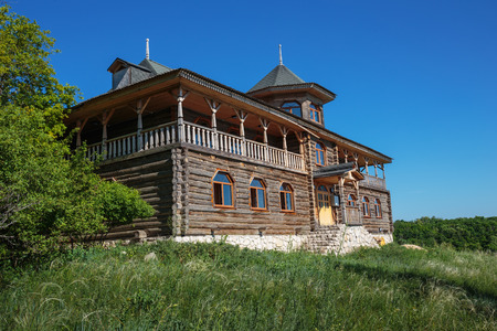 Old wooden house in the village photo