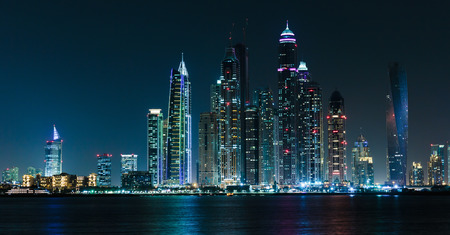 DUBAI, UAE - NOVEMBER 7: General view of the Dubai Marina at night, on November 7, 2013, Dubai, UAE. In the city of artificial channel length of 3 kilometers along the Persian Gulf. photo
