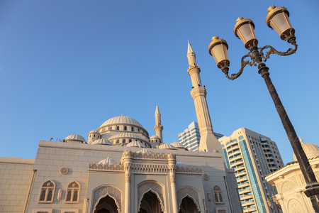 sharjah: SHARJAH, UAE - NOVEMBER 6, 2013  Mosque at sunrise in Sharjah  It is the most industrialized emirate in UAE  Editorial